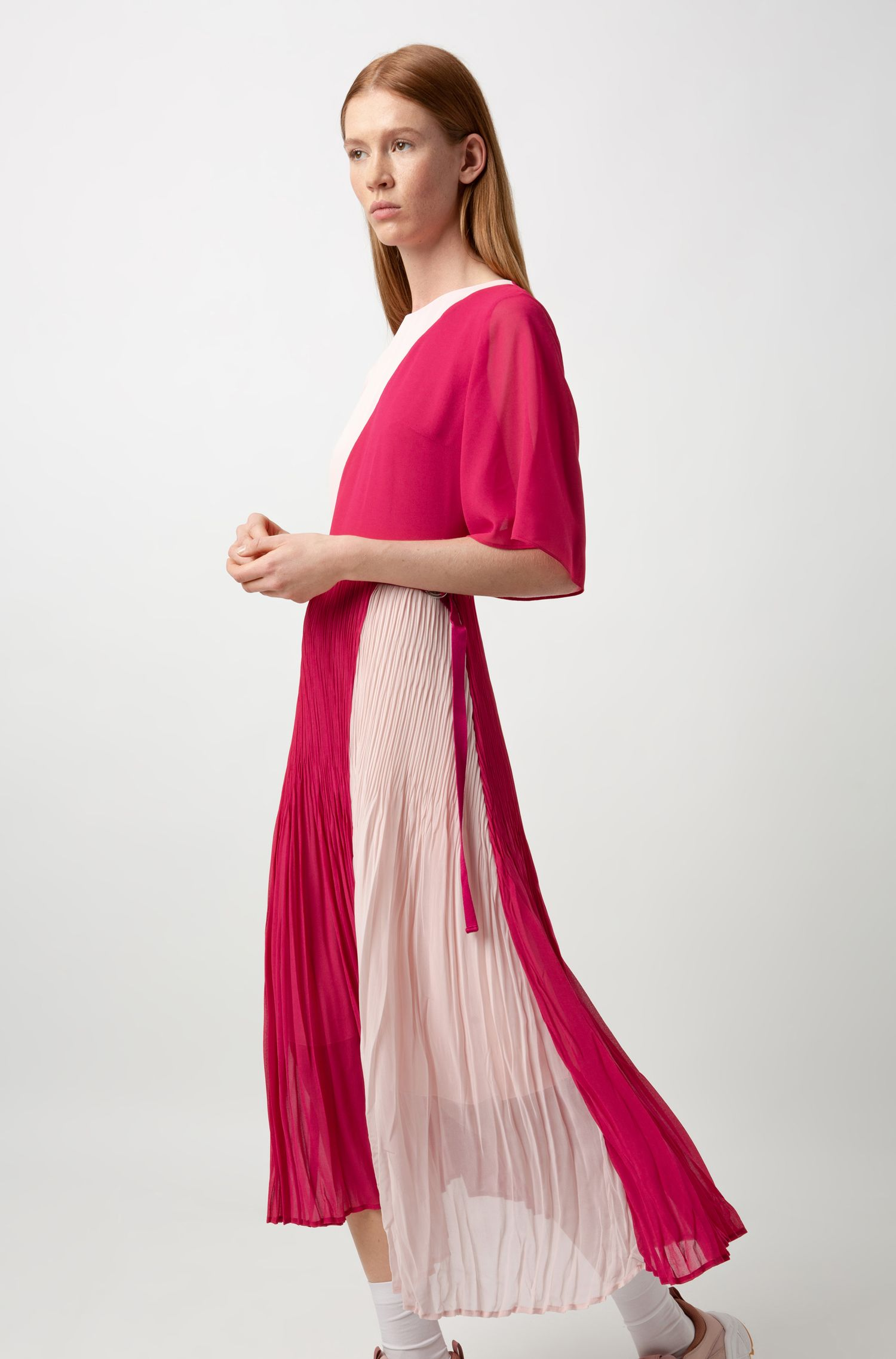 Kleid in Colour-Block-Optik mit Plissee-Rock und transparenten Ärmeln, Pink