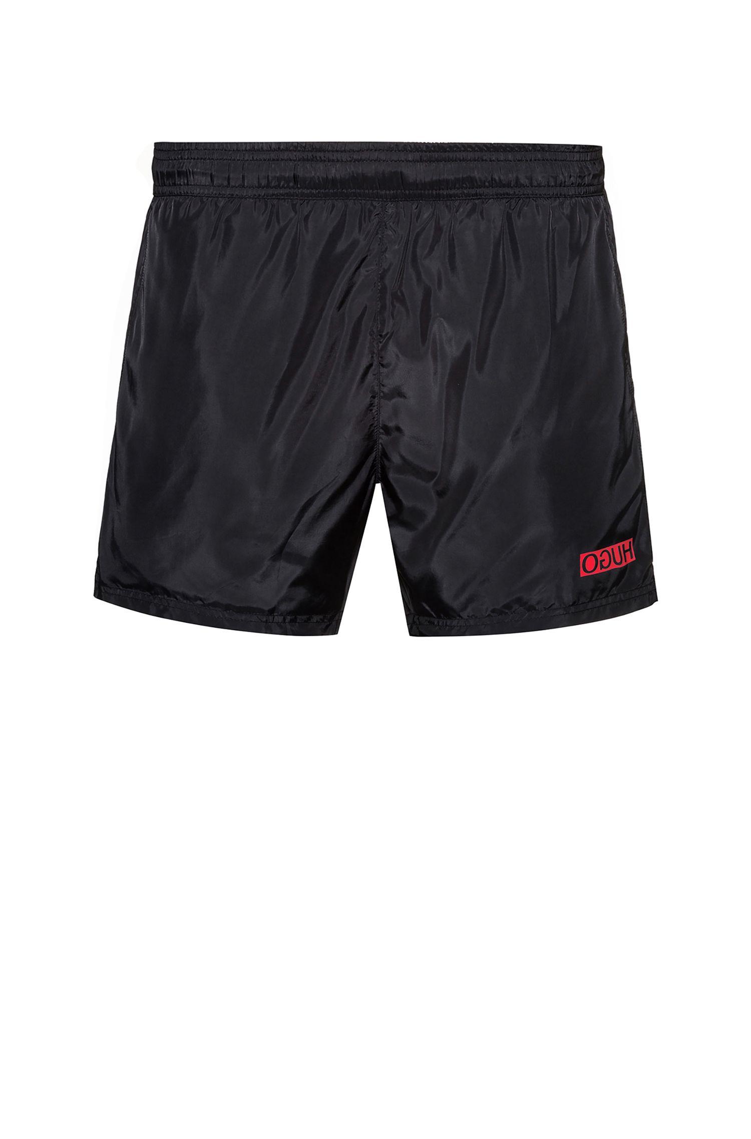 Zwemshort van glanzend, sneldrogend materiaal met gespiegeld logo, Zwart