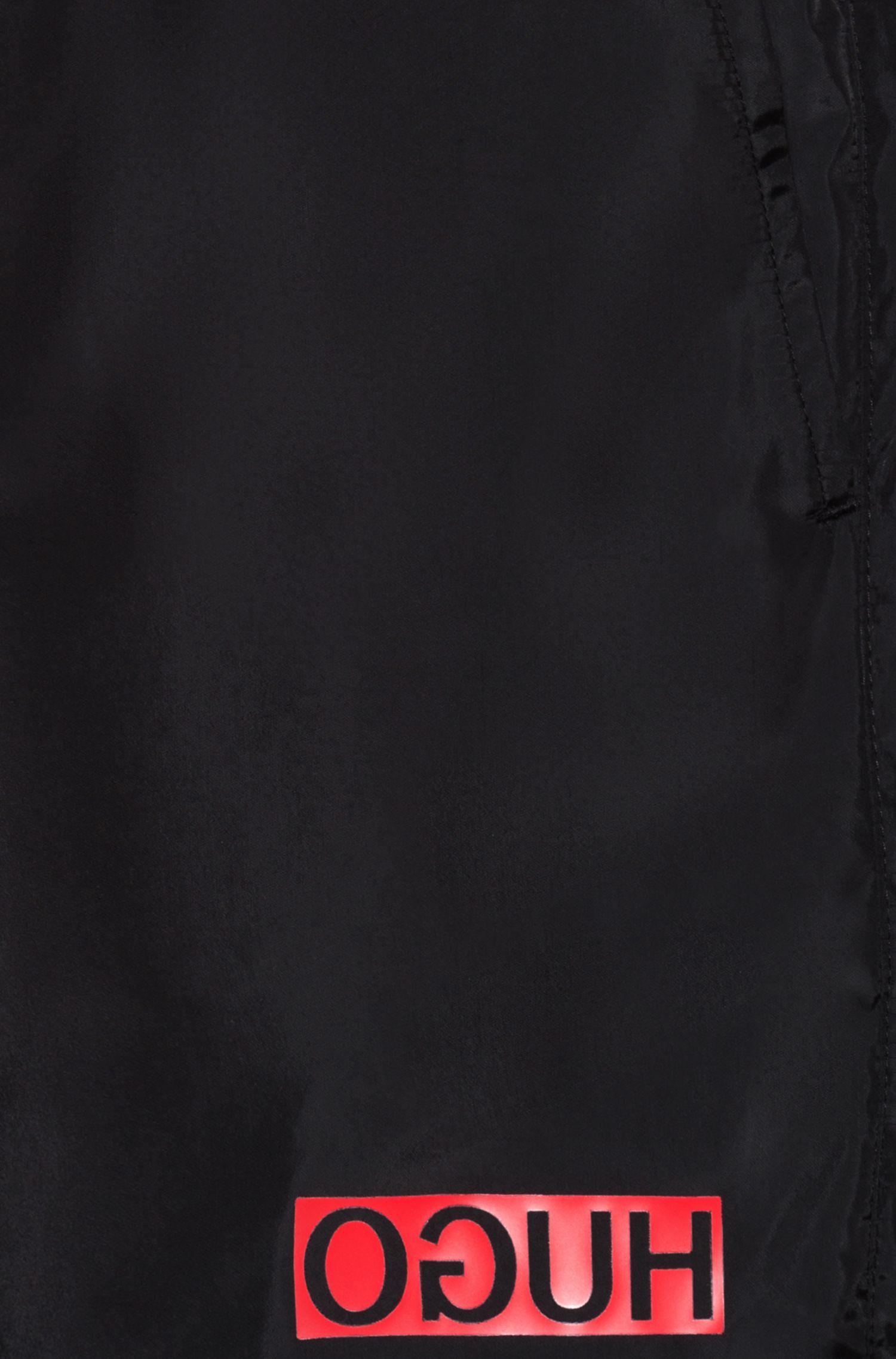 Reverse-logo swim shorts in lustrous quick-dry fabric, Nero