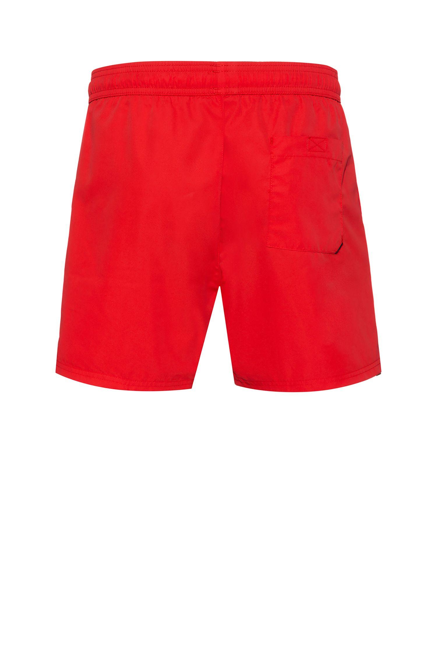 Sneldrogende zwemshort met gespiegelde beer-patch, Rood