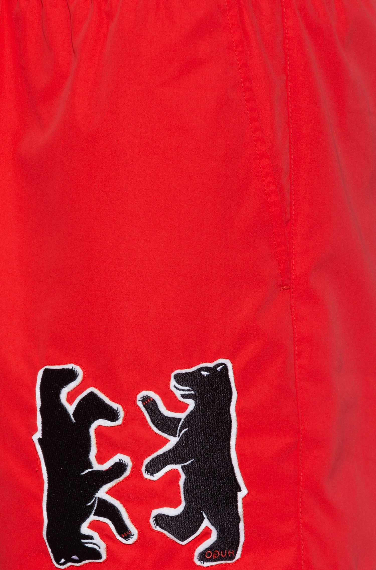 Boxer da mare ad asciugatura rapida con orso reversed applicato, Rosso