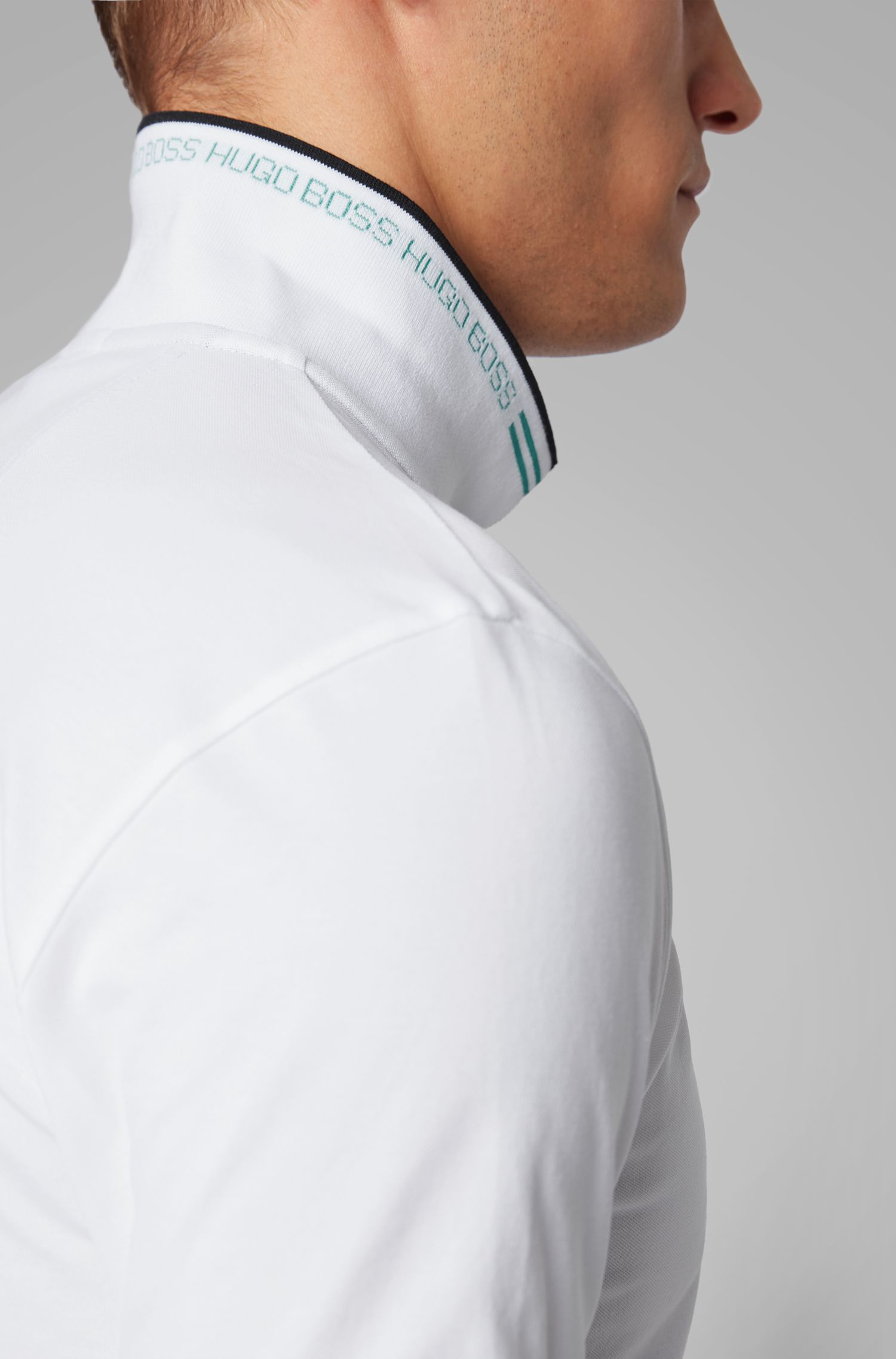 Slim-Fit Poloshirt aus Stretch-Piqué mit geschwungenem Logo, Natur