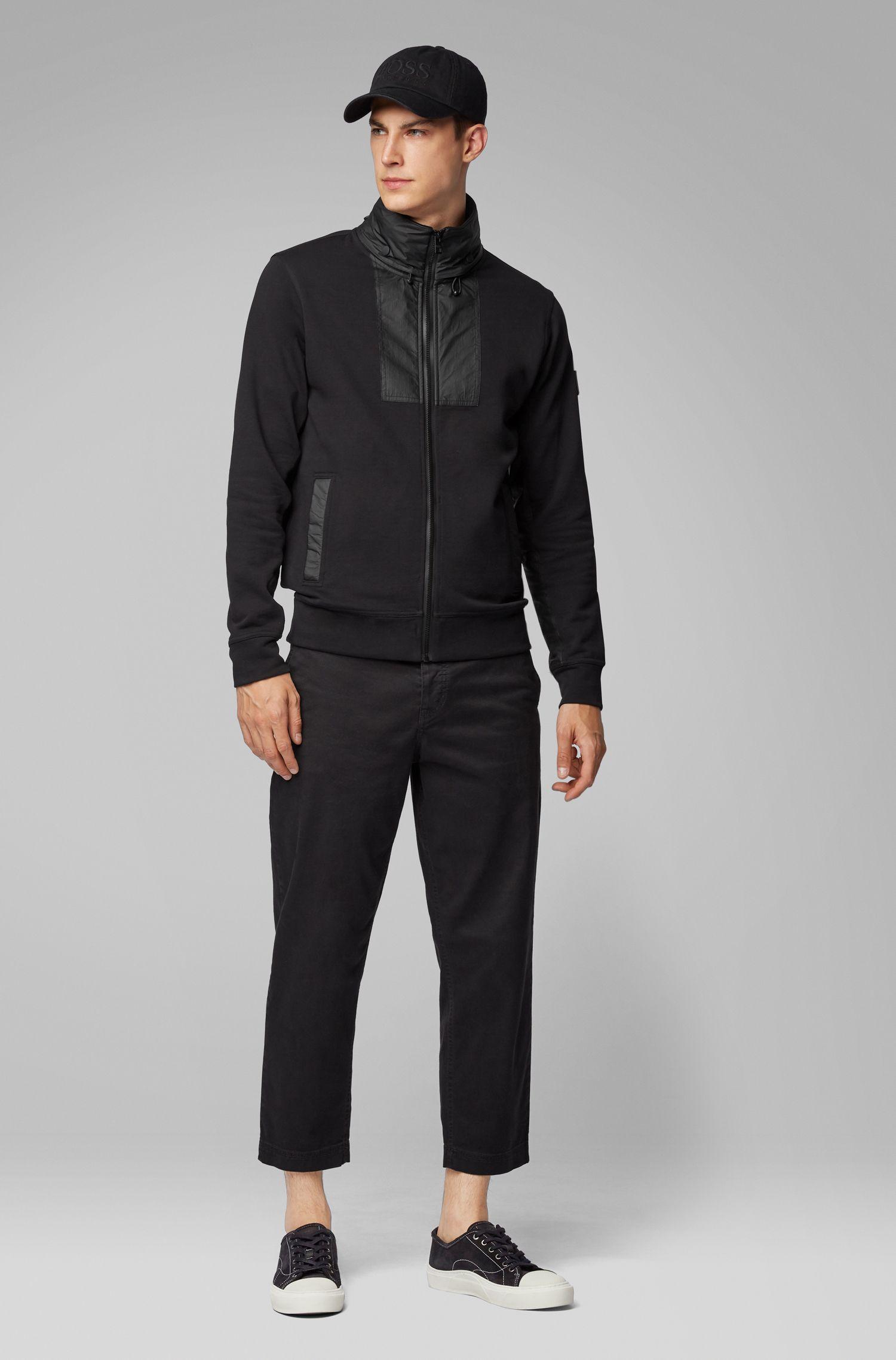 Relaxed-Fit Jacke aus Baumwoll-Jersey mit verstaubarer Tyvek®-Kapuze, Schwarz