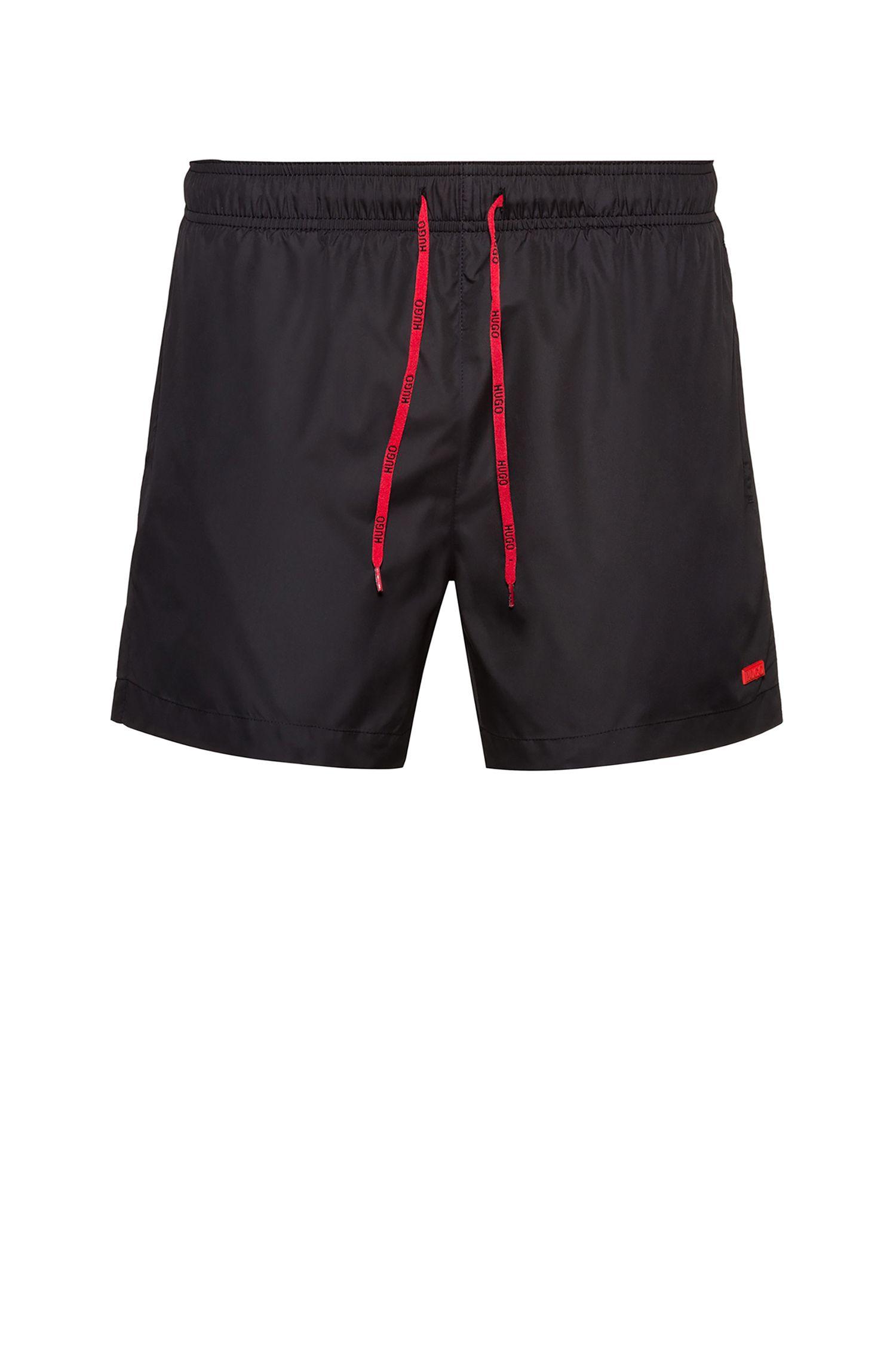 Sneldrogende zwemshort met rubberen logopatch, Zwart
