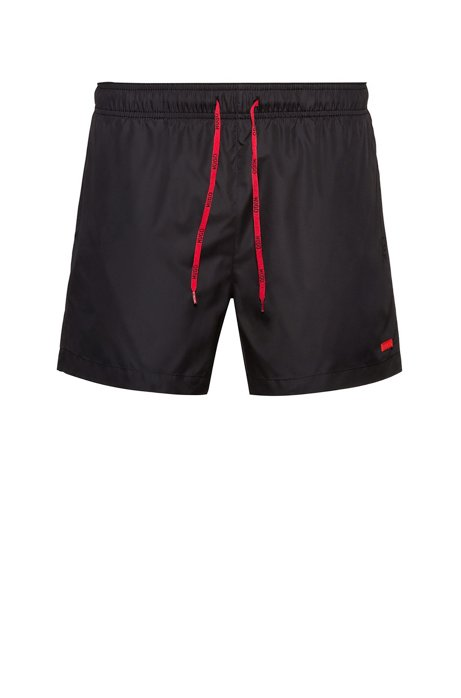 Quick-dry swim shorts with rubber logo badge, Black