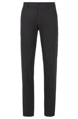 Pantalones slim fit en tejido transpirable, Negro