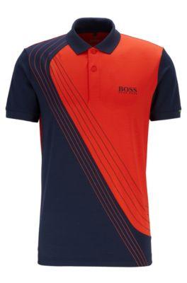 Martin Kaymer colour-block polo shirt in moisture-wicking piqué, Dark Blue
