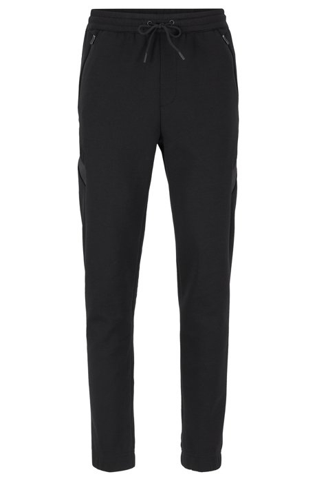 Slim-fit jogging trousers in moisture-wicking stretch fabric, Black