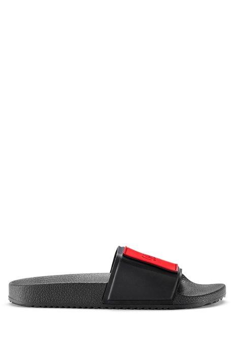 Unisex Italian-made slides with reversed-logo strap, Black