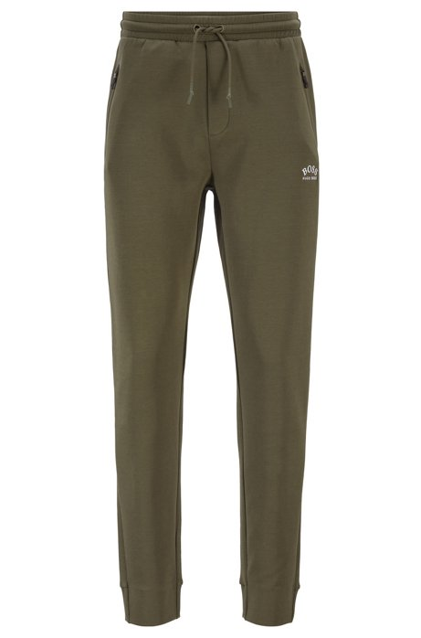 Half-cuffed jogging trousers with curved logo, Dark Green