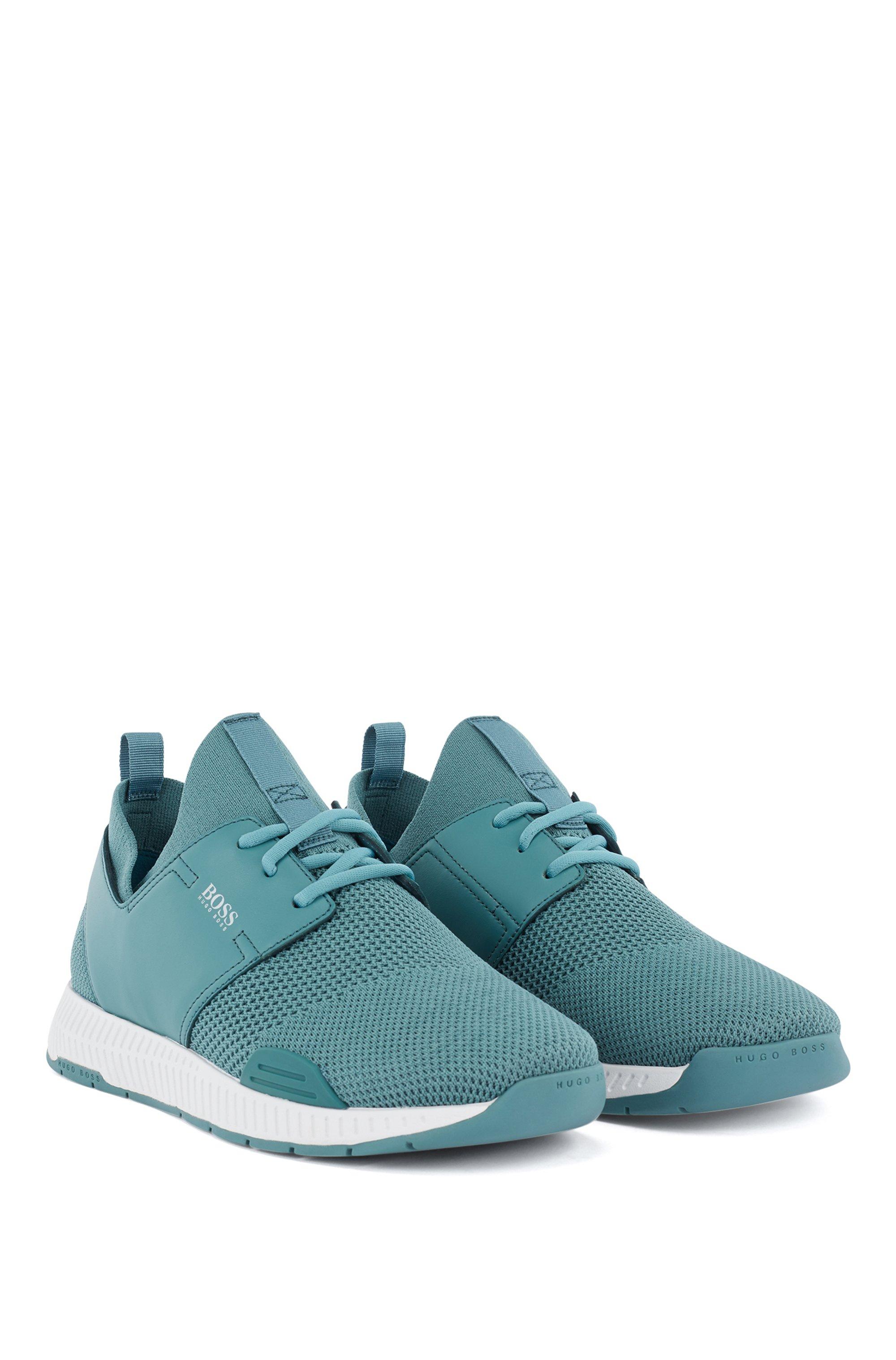 Unisex-Sneakers aus Stretch-Strick mit Ledereinsätzen