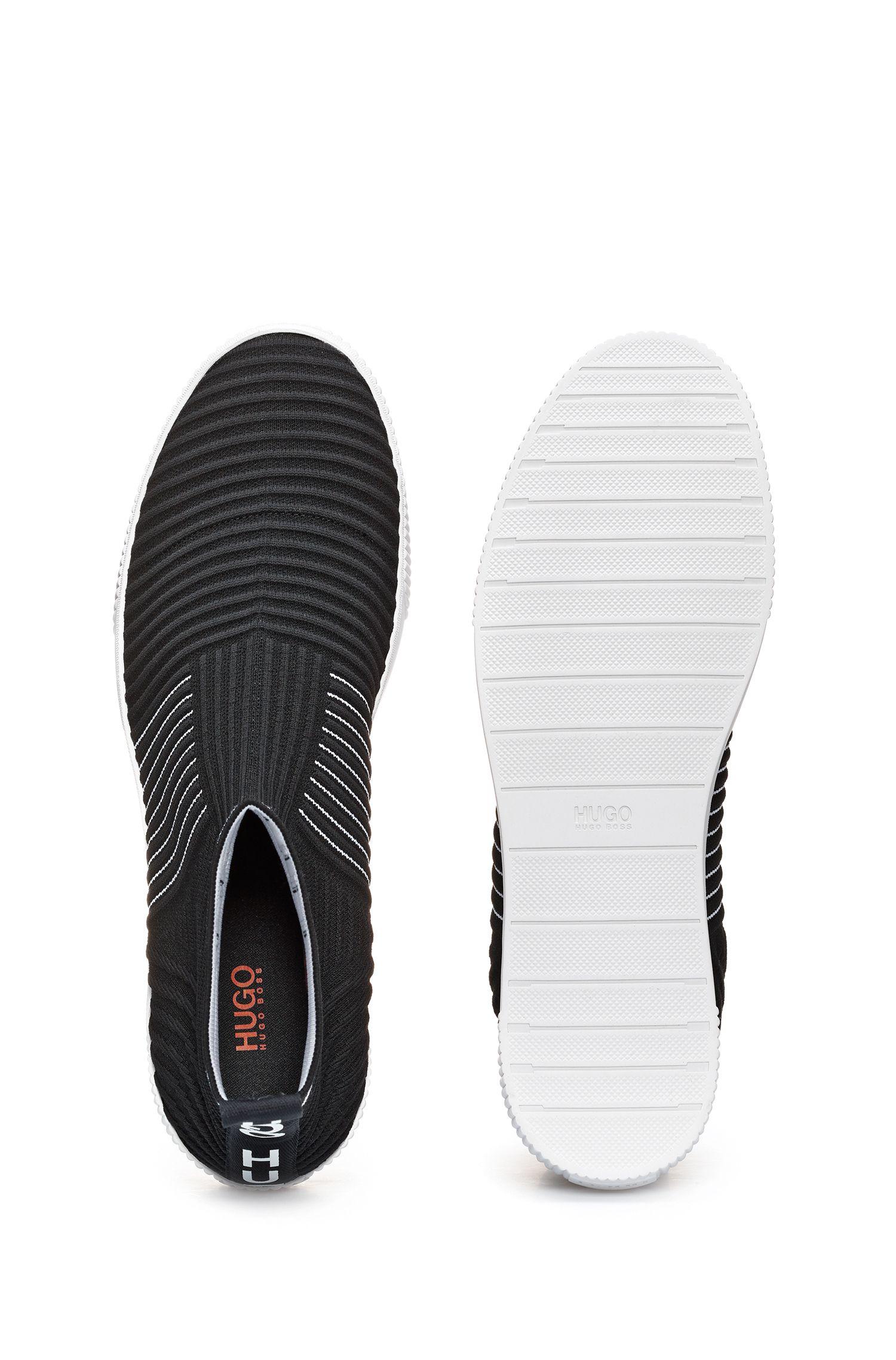 Hightop Sneakers aus geripptem Strick mit spiegelverkehrtem Logo, Schwarz