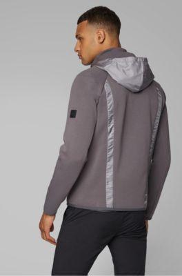 Sudadera con cremallera integral, parte delantera acolchada y capucha desmontable