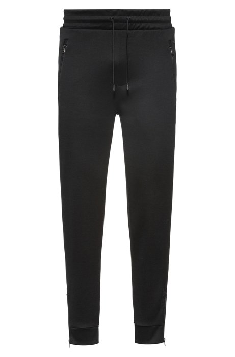 Regular-fit jogging trousers in cotton with zipped hems, Black