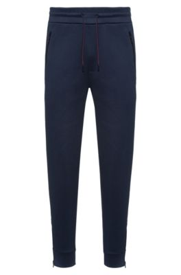 Pantalon de jogging Regular Fit en coton mélangé, zippé au bas des jambes, Bleu foncé