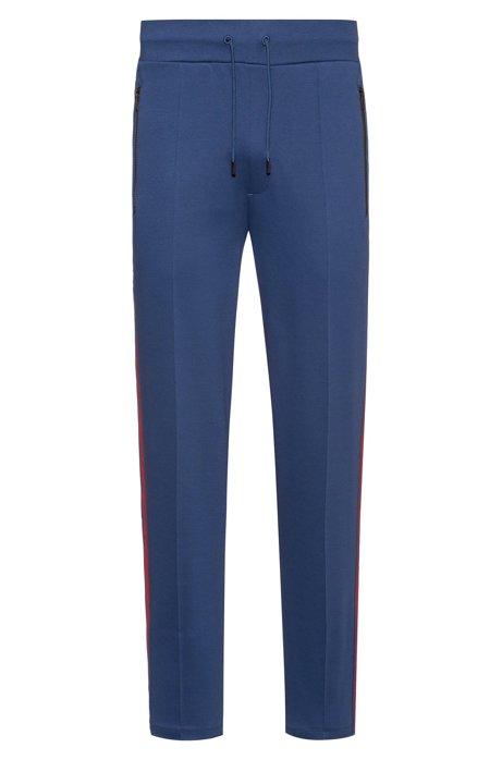 Relaxed-Fit Jogginghose mit Print-Streifen an den Seiten, Blau