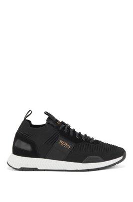 Baskets hybrides style chaussures de course avec chaussette en maille, Noir