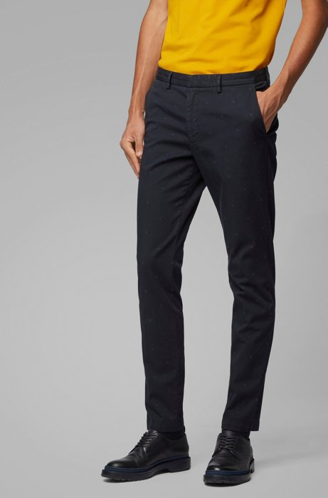 Chinos slim fit de tejido de gabardina de algodón elástico con monogramas estampados, Azul oscuro