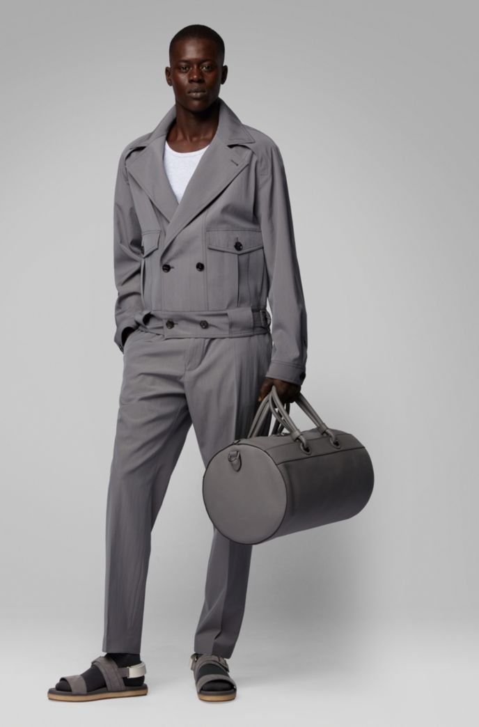 Tubular holdall in calf leather with detachable shoulder strap