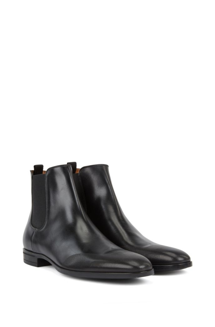 Chelsea boots in burnished leather with laser-cut details