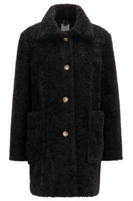 Cappotto regular fit effetto peluche con colletto rialzato, Nero