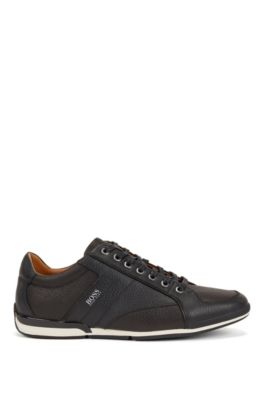 Low-top trainers in grained leather with perforated details, Black