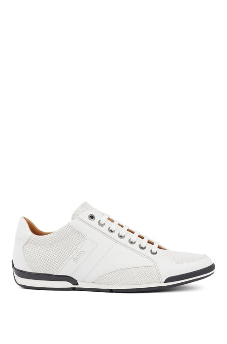 Low-top trainers in grained leather with perforated details, White