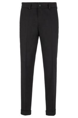 Pantaloni relaxed fit in cotone elasticizzato con lunghezza alla caviglia, Nero