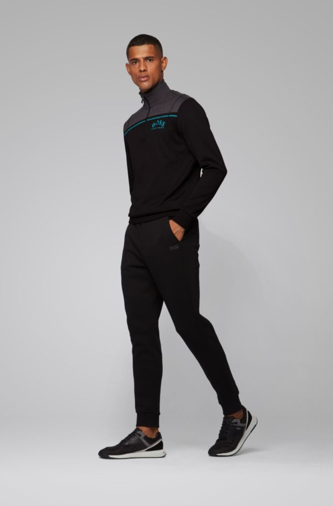Regular-fit sweatshirt with curved logo and quarter zip