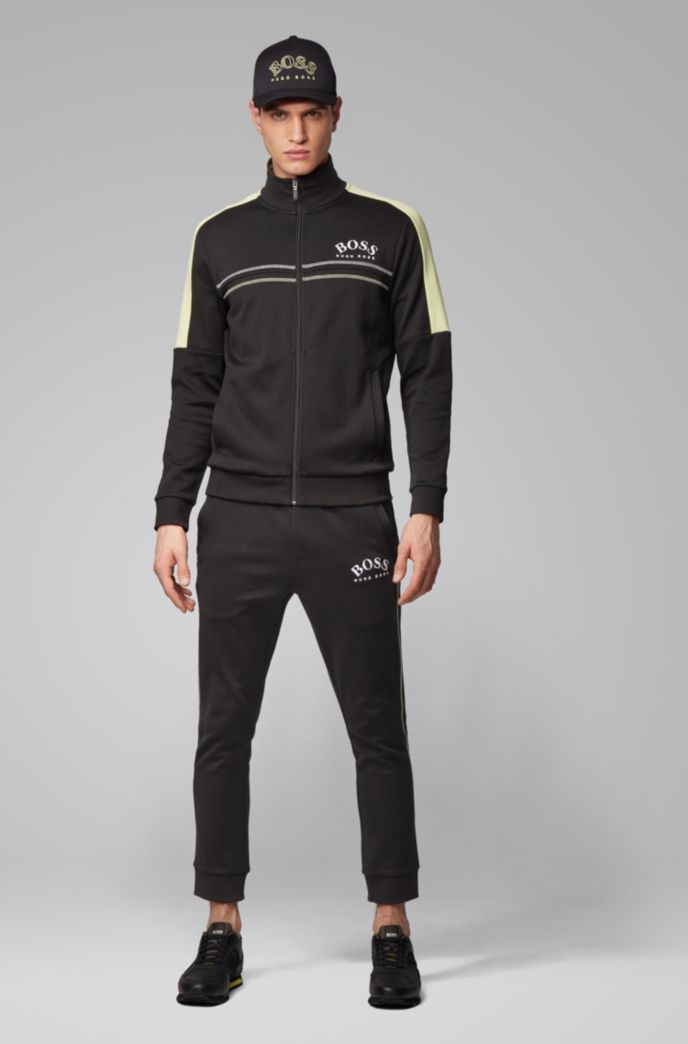Slim-fit jogging trousers with curved logo