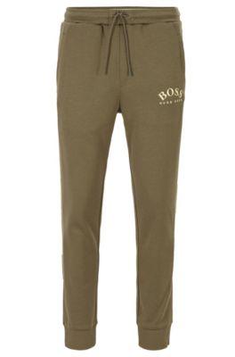Pantalon de survêtement Slim Fit à logo incurvé, Vert sombre