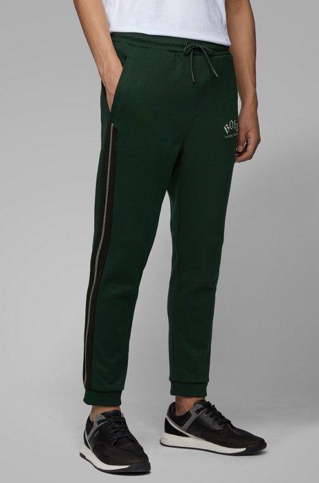 Pantaloni da jogging slim fit con logo curvo, Calce