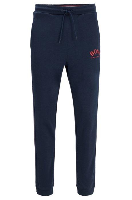 Pantalones de chándal slim fit con logo curvado, Azul oscuro