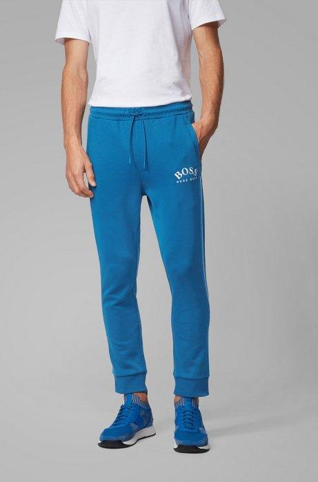 Pantalon de survêtement Slim Fit à logo incurvé, Bleu