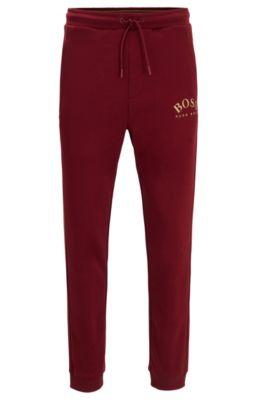 Pantalon de survêtement Slim Fit à logo incurvé, Rouge