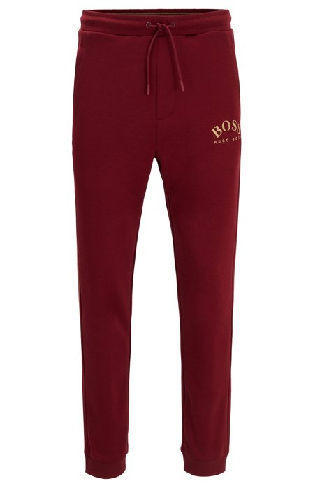 Pantalon de survêtement Slim Fit à logo incurvé, Rouge