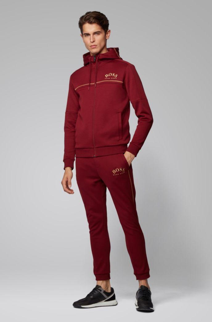 Pantaloni da jogging slim fit con logo curvo