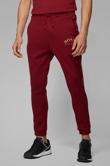 Slim-fit jogging trousers with curved logo, Red