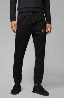 Slim-fit jogging trousers with logo and cuffed hems, Black