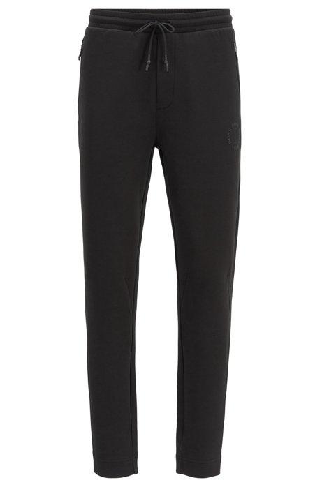 Pantalon de survêtement Regular Fit à logo circulaire, Noir