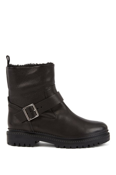 Shearling-lined boots in Italian leather with buckle detail, Black