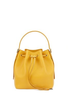 Bucket bag in printed Italian leather with signature hardware, Dark Yellow