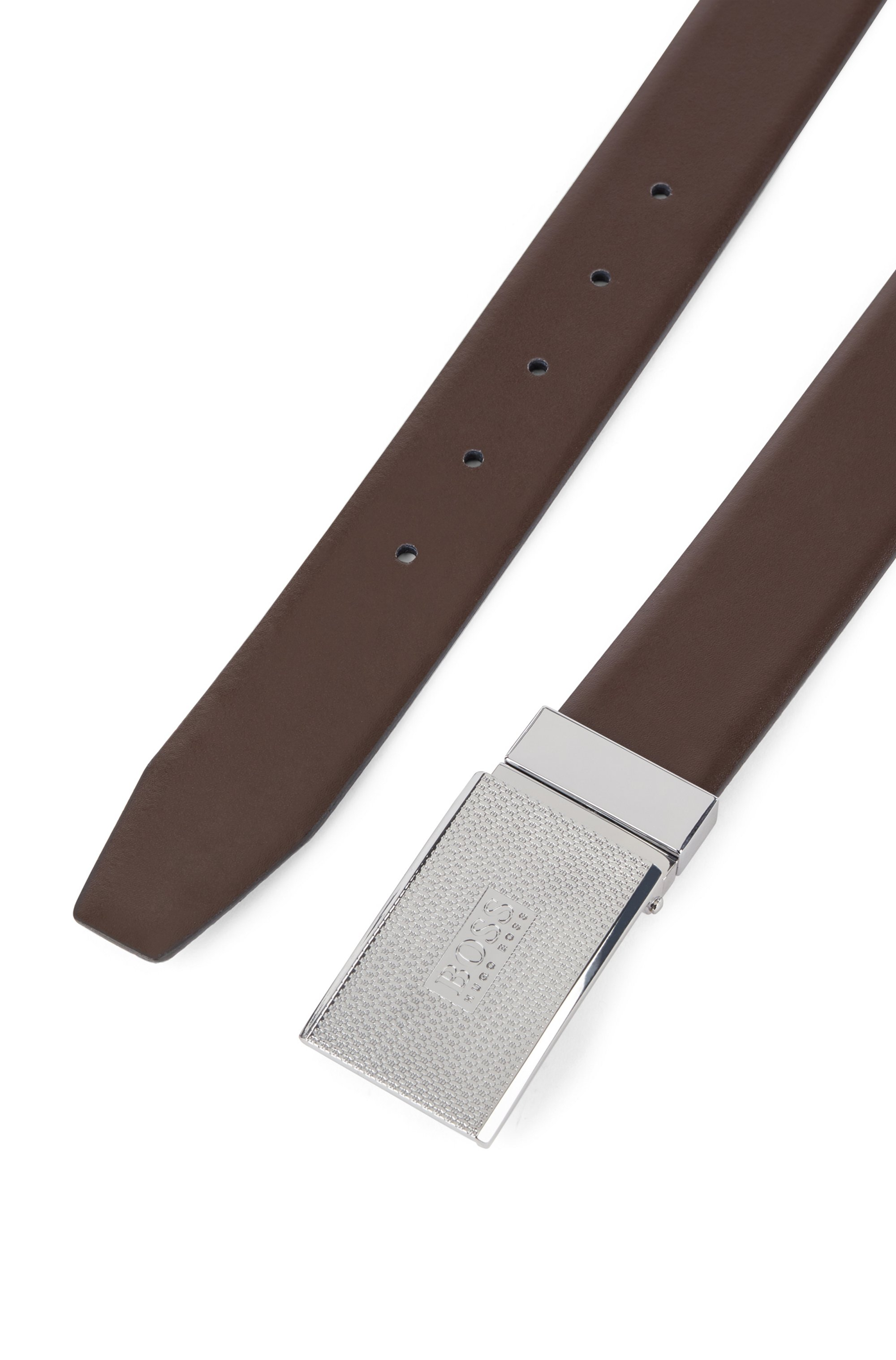 Reversible leather belt with pin and plaque buckles