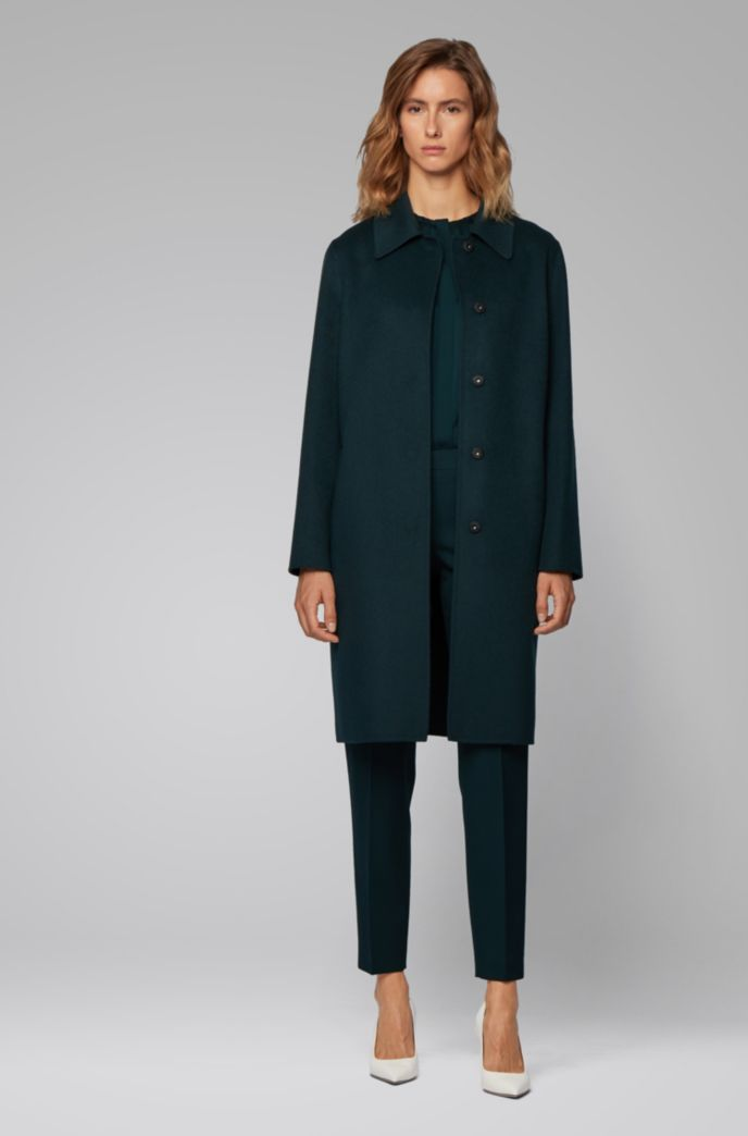 Relaxed-fit coat in hand-stitched fabrics