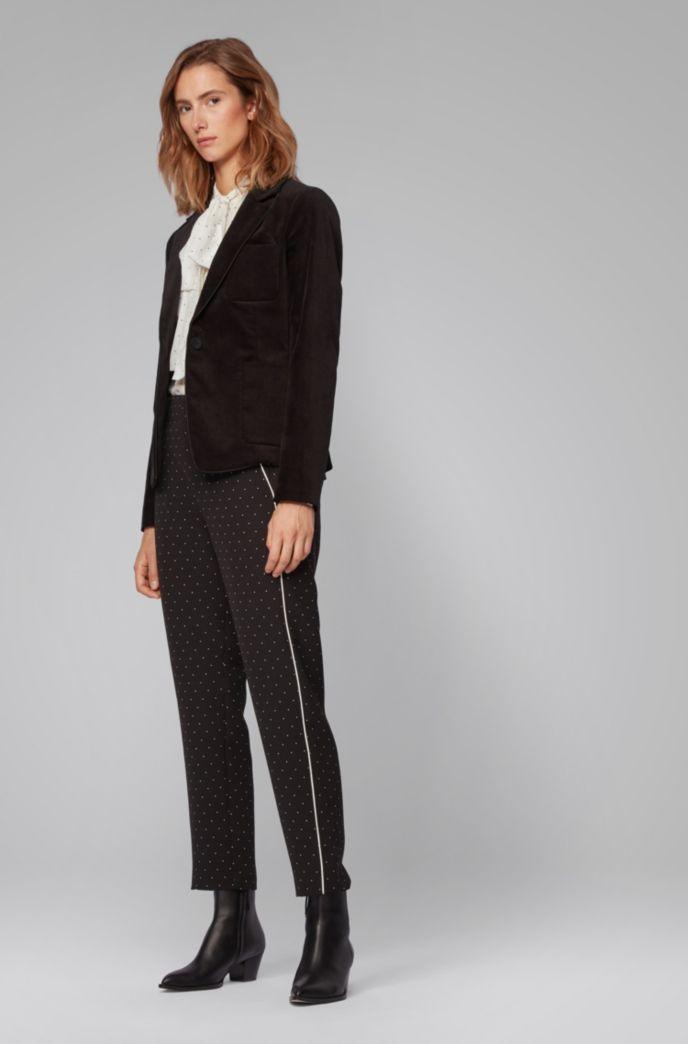 Pantalones de chándal regular fit con ribeteado satinado