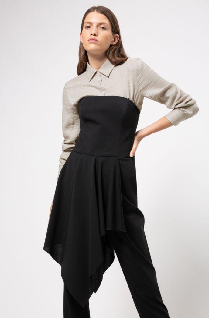 Mouwloze jumpsuit van stretchwol met volantdetail