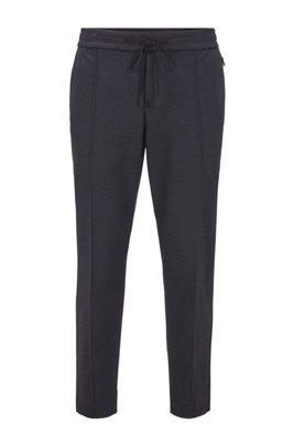 Pantalones tapered fit en punto estampado con largo tobillero, Negro