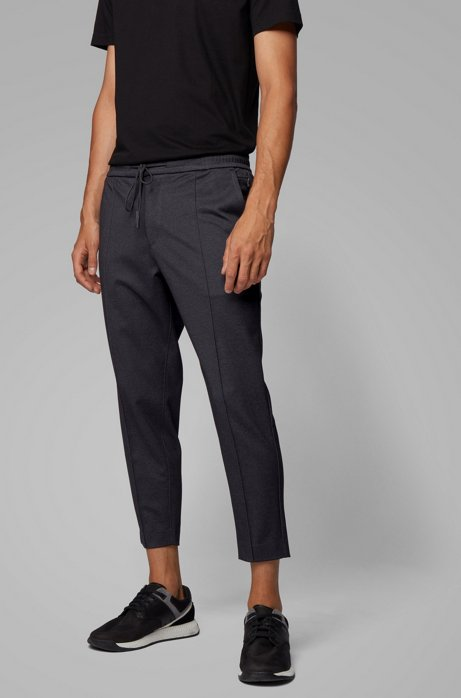 Tapered-fit trousers in printed jersey with cropped length, Black