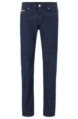 Jeans slim fit in denim elasticizzato italiano con cimosa, Blu scuro