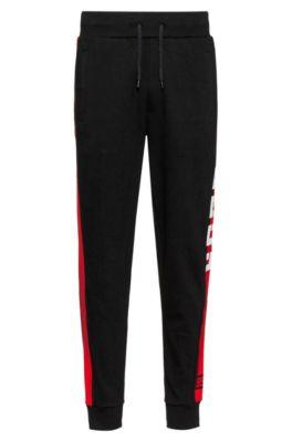 Hose aus Interlock-Jersey mit kontrastierenden Seitenstreifen, Schwarz